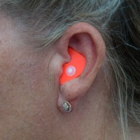 Orange NoiseBreaker in the ear